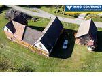 Baugrund mit landwirtschaftlichen Gebäuden in sonniger Hügellandschaft!