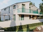 NEUE Belagsfertige 5-6 Zimmer Doppelhaushälfte im Zentrum Parndorfs samt SW Garten!