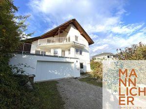RUHELAGE, FERNBLICK, 30 AUTOMINUTEN NACH WIEN - Architektenhaus mit Einliegerwohnung, südseitiger Terrasse und Garage für 3 Pkws