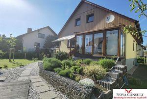 Einfamilienhaus mit idyllischem Naturschwimmteich!