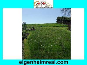 Familienfreundliche Eigentumswohnung mit Eigengarten mit Garten