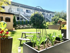 Sonnige 4 Zimmerwohnung mit Terrasse & Garten