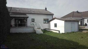 Grosszügiges Zweifamilienhaus mit Garten , Terrasse und Garage / Neusiedl am See